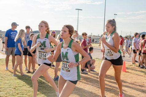 Senior Kate Skarky, and sophomores Emery Atchison and Margot Knudtson heads to the finish line.
